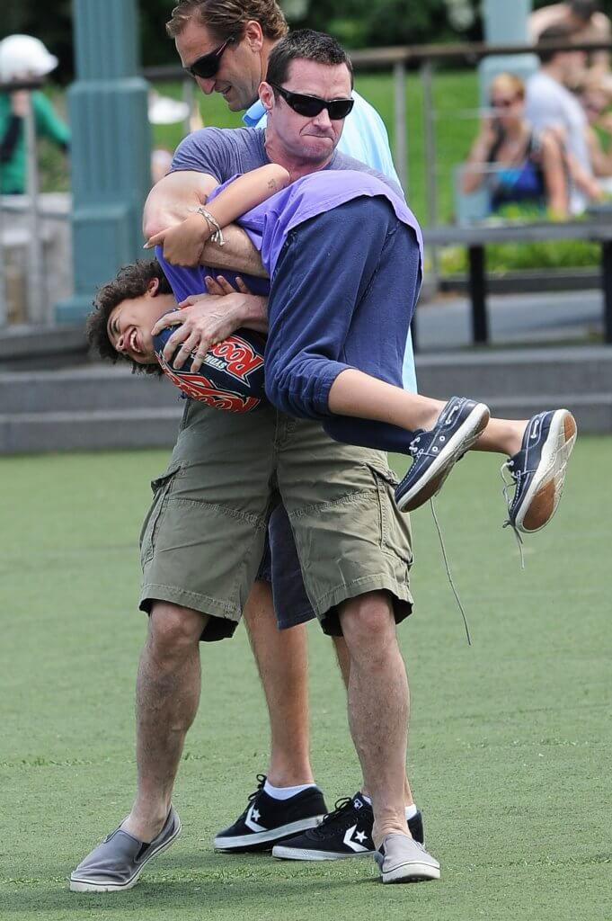Hugh Jackman and Oscar Jackman play rugby and visit a West Village playground. Pictured: Hugh Jackman and Oscar Jackman Ref: SPL404363 100612 Picture by: Doug Meszler / Splash News Splash News and Pictures Los Angeles:310-821-2666 New York: 212-619-2666 London: 870-934-2666 photodesk@splashnews.com